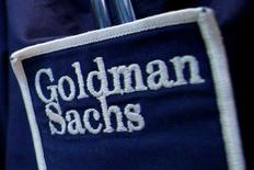 The logo of Dow Jones Industrial Average stock market index listed company Goldman Sachs (GS) is seen on the clothing of a trader working at the Goldman Sachs stall on the floor of the New York Stock Exchange, United States April 16, 2012. REUTERS/Brendan McDermid/File Photo