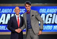 Jun 26, 2014; Brooklyn, NY, USA; Dario Saric (Croatia) shakes hands with NBA commissioner Adam Silver after being selected as the number twelve overall pick to the Orlando Magic in the 2014 NBA Draft at the Barclays Center. Mandatory Credit: Brad Penner-USA TODAY Sports