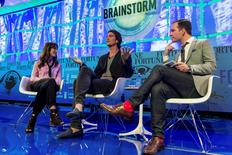 Adam Neumann (C), CEO of WeWork, and his wife Rebekah Newmann (L), chief brand officer for the company, are shown onstage as they are interviewed by Fortune's Andrew Nusca during the Fortune Brainstorm Tech conference in Aspen, Colorado, U.S. July 11, 2016.  Stuart Isett/Fortune Brainstorm TECH/Handout via Reuters