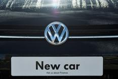 Signage for a new Volkswagen car is seen at a dealership in London, Britain, March 30, 2016. REUTERS/Toby Melville/File Photo