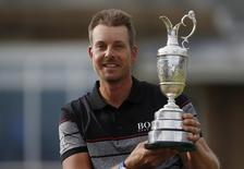 Golf - British Open - Sweden's Henrik Stenson celebrates with the Claret Jug after winning the British Open golf championship - Royal Troon, Scotland, Britain - 17/07/2016.           REUTERS/Craig Brough