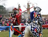Performers dressed as medieval knights joust at Knebworth House in Hertfordshire, Britain April 1, 2013.  REUTERS/Olivia Harris/File Photo