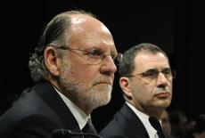 Former MF Global CEO Jon Corzine (L) and COO Bradley Abelow (R) testify before a House Financial Services Committee Oversight and Investigations Subcommittee hearing on the collapse of MF Global, at the U.S. Capitol in Washington, December 15, 2011.  REUTERS/Jonathan Ernst