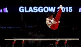 Japan's Kohei Uchimura competes on the parallel bars during the men's all-around final at the World Gymnastics Championships at the Hydro arena in Glasgow, Scotland, October 30, 2015. REUTERS/Russell Cheyne