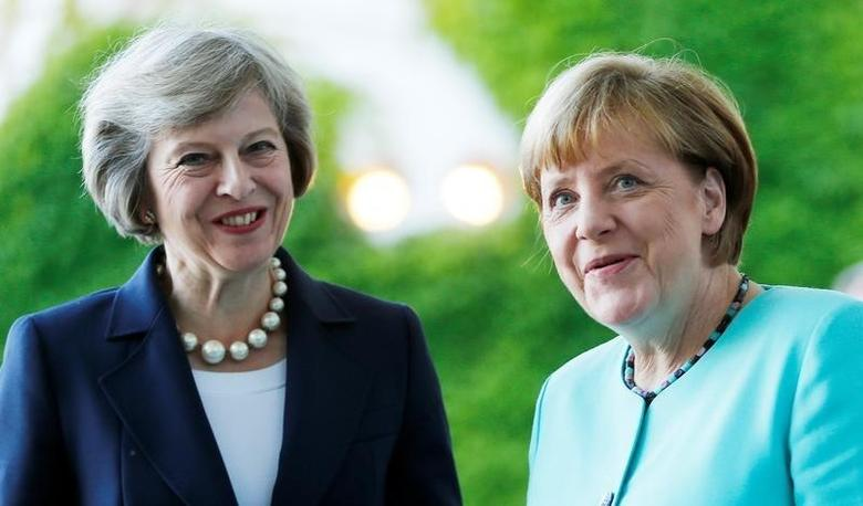German Chancellor Angela Merkel greets British Prime Minister Theresa May (L) during a welcoming ceremony at the Chancellery in Berlin, Germany July 20, 2016.  REUTERS/Hannibal Hanschke/File Photo