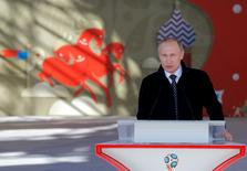 Russian President Vladimir Putin delivers a speech during the launching ceremony of the 2018 World Cup and 2017 Confederations Cup volunteer campaign in Moscow, Russia, June 1, 2016.  REUTERS/Maxim Shemetov