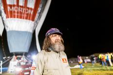Russian adventurer Fedor Konyukhov is seen in front of his balloon as it is inflated before the start of his record attempt for a solo hot-air balloon flight around the globe near Perth, Australia, in this handout image received July 12, 2016.    Oscar Konyukhov/Handout via REUTERS