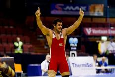 Narsingh Pancham Yadav of India celebrates after he won the men's 74kg freestyle weight class during the Vantaa Cup finals in Vantaa May 4, 2012. REUTERS/Roni Rekomaa/Lehtikuva