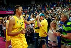 Australia's Liz Cambage celebrates with fans after the women's bronze medal basketball match against Russia at the North Greenwich Arena during the London 2012 Olympic Games August 11, 2012.              REUTERS/Sergio Perez