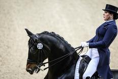 Inessa Merkulova of Russia rides her horse Mister X during the Reem Acra FEI World Cup dressage Grand Prix event during the Gothenburg Horse Show at Scandinavium Arena in Gothenburg, Sweden March 25, 2016. REUTERS/Bjorn Larsson Rosvall/TT News Agency