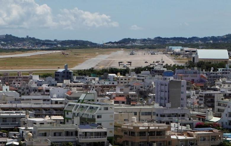 Osprey military aircraft are seen at the U.S. Futenma airbase in Ginowan, on the southern Japanese island of Okinawa, July 26, 2013. REUTERS/Nathan Layne/File Photo