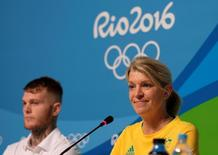 Kitty Chiller (R), Chef de Mission for Australia at the Rio 2016 Olympic Games, leads a news conference with boxer Daniel Lewis in which she described the problems that her country's delegation encountered with the athletes' housing in Rio de Janeiro, July 25, 2016. REUTERS/Rickey Rogers