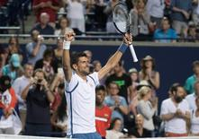 Jul 30, 2016; Toronto, Ontario, Canada; Novak Djokovic celebrates after winning the singles semi final match at the Rogers Cup tennis tournament at Aviva Centre. Mandatory Credit: Nick Turchiaro-USA TODAY Sports