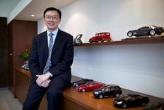 Matthew (Matt) Tsien, president of General Motors (GM) China, poses for a photograph next to GM car scale models in his office at the company's headquarters in Shanghai, China February 18, 2014. REUTERS/Aly Song/File Photo