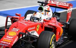 Scuderia Ferrari's German driver Sebastian Vettel is seen in the pits during the Formula One Hungarian Grand Prix at the Hungaroring circuit in Mogyorod near Budapest, Hungary, on July 24, 2016.  REUTERS/ANDREJ ISAKOVIC