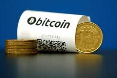 A Bitcoin (virtual currency) paper wallet with QR codes and a coin are seen in an illustration picture shot May 27, 2015.  REUTERS/Benoit Tessier/Illustration
