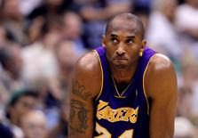 Fomer Los Angeles Lakers guard Kobe Bryant pauses during a break in playing against the Utah Jazz during Game 4 of their NBA Western Conference semi-final playoff series in Salt Lake City, Utah, in this file May 10, 2010 photo.  REUTERS/Lucy Nicholson
