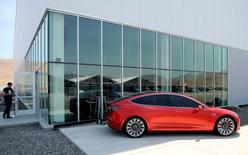 A prototype of the Tesla Model 3 is on display in front of the factory during a media tour of the Tesla Gigafactory which will produce batteries for the electric carmaker in Sparks, Nevada, U.S. July 26, 2016.  REUTERS/James Glover II