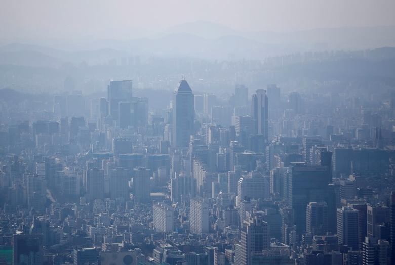 The skyline of central Seoul is seen during a foggy day in Seoul March 4, 2015. REUTERS/Kim Hong-Ji