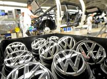 Emblems of VW Golf VII car are pictured in a production line at the plant of German carmaker Volkswagen in Wolfsburg, February 25, 2013. REUTERS/Fabian Bimmer/File Photo - RTSKOGI