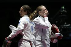 2016 Rio Olympics - Fencing - Final - Women's Epee Individual Gold Medal Bout - Carioca Arena 3 - Rio de Janeiro, Brazil - 06/08/2016. Emese Szasz (HUN) of Hungary (R) celebrates winning the match.  REUTERS/Issei Kato