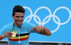 2016 Rio Olympics - Cycling Road - Victory Ceremony - Men's Road Race Victory Ceremony - Fort Copacabana - Rio de Janeiro, Brazil - 06/08/2016. Greg Van Avermaet (BEL) holds the gold medal.   REUTERS/Phil Walter/Pool