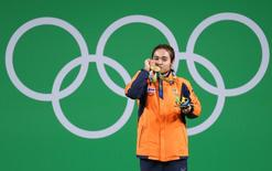 2016 Rio Olympics - Weightlifting - Victory Ceremony - Women's 48kg - Riocentro - Pavilion 2 - Rio de Janeiro, Brazil - 06/08/2016. Sopita Tanasan (THA) of Thailand poses with her medal. REUTERS/Kai Pfaffenbach