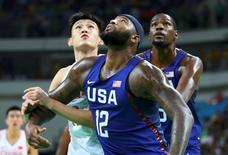 2016 Rio Olympics - Basketball - Preliminary - Men's Preliminary Round Group A China v USA - Carioca Arena 1 - Rio de Janeiro, Brazil - 06/08/2016. Demarcus Cousins (USA) of USA, Kevin Durant (USA) of the USA and Li Muhao (CHN) of China (PRC) compete. REUTERS/Lucy Nicholson
