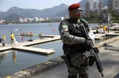 2016 Rio Olympics - Rowing - Preliminary - Women's Quadruple Sculls Heats - Lagoa Stadium - Rio De Janeiro, Brazil - 06/08/2016. A security guard stands by the Lagoa rowing venue REUTERS/Murad Sezer