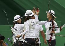 2016 Rio Olympics - Archery - Semifinal - Women's Team Semifinal - Sambodromo - Rio de Janeiro, Brazil - 07/08/2016. (L-R) South Korea's Chang Hye-Jin (KOR), Ki Bo-Bae (KOR) and Choi Mi-Sun (KOR) celebrate. REUTERS/Yves Herman