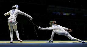 2016 Rio Olympics - Fencing - Quarterfinal - Women's Epee Individual Quarterfinals - Carioca Arena 3 - Rio de Janeiro, Brazil - 06/08/2016. Lauren Rembi (FRA) of France competes with Nathalie Moellhausen (BRA) of Brazil. REUTERS/Issei Kato