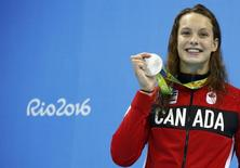 2016 Rio Olympics - Swimming - Victory Ceremony - Women's 100m Butterfly Victory Ceremony - Olympic Aquatics Stadium - Rio de Janeiro, Brazil - 07/08/2016. Penelope Oleksiak (CAN) of Canada poses with her medal. REUTERS/David Gray