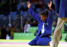 Rafaela Silva (BRA) of Brazil celebrates. REUTERS/Kai Pfaffenbach