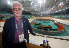 UCI president Brian Cookson stands near the track during a practice session.  REUTERS/Eric Gaillard