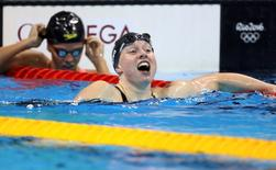 2016 Rio Olympics - Swimming - Final - Women's 100m Breaststroke Final - Olympic Aquatics Stadium - Rio de Janeiro, Brazil - 08/08/2016. Lilly King (USA) of USA celebrates  REUTERS/Stefan Wermuth