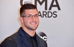 Tim Tebow arrives at the 48th Country Music Association Awards in Nashville, Tennessee November 5, 2014.   REUTERS/Eric Henderson