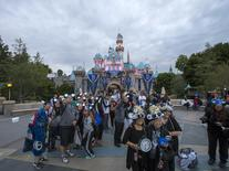 People pose for photos during Disneyland's Diamond Celebration in Anaheim, California May 22, 2015. The Disneyland Resort is celebrating the 60th anniversary with a 24-hour open day.  REUTERS/Mario Anzuoni - RTX1E7MI
