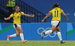 2016 Rio Olympics - Soccer - Preliminary - Women's First Round - Group G Colombia v USA - Amazonia Stadium - Manaus, Brazil - 09/08/2016. Catalina Usme (COL) of Colombia celebrates a goal with Tatiana Ariza (COL) of Colombia. REUTERS/Bruno Kelly