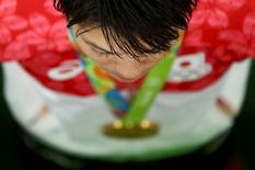 2016 Rio Olympics - Artistic Gymnastics - Final - Men's Individual All-Around Final - Rio Olympic Arena - Rio de Janeiro, Brazil - 10/08/2016.  Kohei Uchimura (JPN) of Japan poses with his gold medal, REUTERS/Kai Pfaffenbach