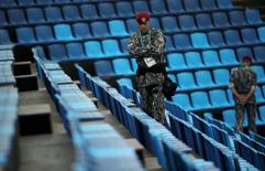 Security personnel stand guard at the equestrian venue. REUTERS/Tony Gentile