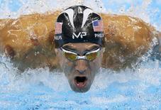 Michael Phelps competes.      REUTERS/Pilar Olivares