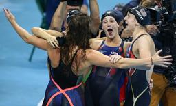 USA's Katie Ledecky, Maya DiRado, Leah Smith and Allison Schmitt celebrate winning gold.  REUTERS/Marcos Brindicci