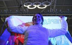 Инна Дериглазова отмечает победу. В пятый день Олимпийских игр в Рио-де-Жанейро российские спортсмены завоевали по одной золотой, серебряной и бронзовой медали.  REUTERS/Issei Kato