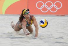 Aug 9, 2016; Rio de Janeiro, Brazil; Larissa Franca Maestrini (BRA) digs the ball against the United States during the women's preliminary in the Rio 2016 Summer Olympic Games at Beach Volleyball Arena. Mandatory Credit: Kevin Jairaj-USA TODAY Sports