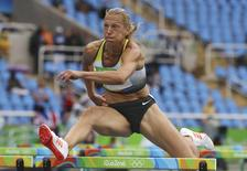 2016 Rio Olympics - Athletics - Women's Heptathlon 100m Hurdles - Olympic Stadium - Rio de Janeiro, Brazil - 12/08/2016. Jennifer Oeser (GER) of Germany competes.    REUTERS/Phil Noble