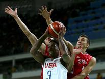 Demar Derozan of the USA, Nikola Kalinic and Bogdan Bogdanovic of Serbia in action. REUTERS/Marko Djurica