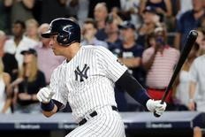Aug 12, 2016; Bronx, NY, USA;  New York Yankees designated hitter Alex Rodriguez (13) hits an RBI double to deep center during the first inning against the Tampa Bay Rays at Yankee Stadium. Mandatory Credit: Anthony Gruppuso-USA TODAY Sports