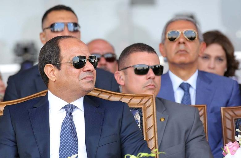 Egyptian President Abdel Fattah al-Sisi (L) attends during the first anniversary of launching the New Suez Canal and the 60th anniversary of nationalizing the Suez Canal in Ismailia, Egypt August 6, 2016 in this handout picture courtesy of the Egyptian Presidency. The Egyptian Presidency/Handout via REUTERS