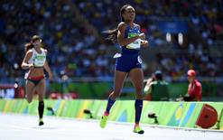 Aug 13, 2016; Rio de Janeiro, Brazil; Allyson Felix (USA) during the women's track and field 400m preliminaries in the Rio 2016 Summer Olympic Games at Estadio Olimpico Joao Havelange. Mandatory Credit: James Lang-USA TODAY Sports