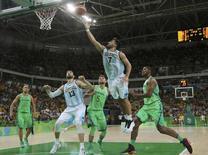 2016 Rio Olympics - Basketball - Preliminary - Men's Preliminary Round Group B Argentina v Brazil - Carioca Arena 1 - Rio de Janeiro, Brazil - 13/08/2016. Facundo Campazzo (ARG) of Argentina makes a layup in double overtime. REUTERS/Jim Young